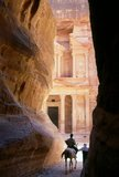 The Siq or al-Siq (Arabic: السيق) (translated: the shaft) is the main entrance to the ancient city of Petra in southern Jordan. The dim, narrow gorge (in some points no more than 3 meters wide) winds its way approximately one mile and ends at Petra's most elaborate ruin, Al Khazneh (The Treasury).<br/><br/>   Petra was first established as a city by the Nabataean Arabs in the 4th century BC, and owed its birth and prosperity to the fact that it was the only place with clear and abundant water between the Hijaz trading centres of Mecca and Medina, and Palestine.<br/><br/>   Hewn directly into the Nubian sandstone ridges of the south Jordanian desert, it seems probable that - given its excellent defensive position and good water supplies - Petra has been continually occupied from as early as Paleolithic times. It is thought to be mentioned in the Bible as Sela, a mountain fortress captured by Amaziah, King of Judah, in the 9th century BC, when the defenders were hurled to their deaths from the summit, and as many as 10,000 people died.<br/><br/>   The city's Latin name, Petra - literally, 'Rock' - probably replaced the biblical name Sela at the time of the Roman conquest some 1,900 years ago. Today, in Arabic, the ancient site is still called Batraa, though the valley in which it is situated is known as Wadi Musa - 'The Valley of Moses' - being one of the places where, according to semitic tradition, the Prophet Moses struck a rock and water gushed forth. Truly Petra is steeped in history.